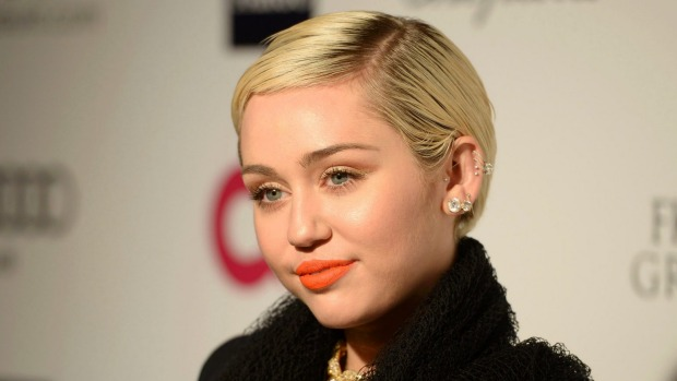 1492135029283 - Miley Cyrus becomes the latest star targeted in a nude photo hacking